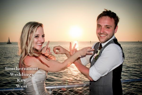 Wedding Couple in front of the setting sun off the coast of Key West, Florida