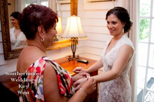 Brides mother helping here get ready - Image by Southernmost Weddings