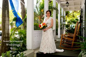 Bride poses on the porch - Image by Southernmost Weddings