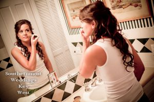 Bride getting ready before the wedding - Image by Southernmost Weddings