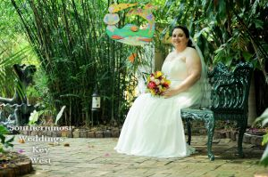Bride waiting in a tropical garden - Image by Southernmost Weddings