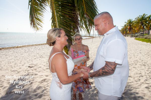 Wedding officiant performs a ceremony on Smathers Beach in Key West, FL.