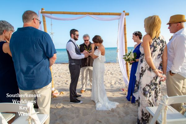 Wedding officiant performs a wedding ceremony on Smathers Beach