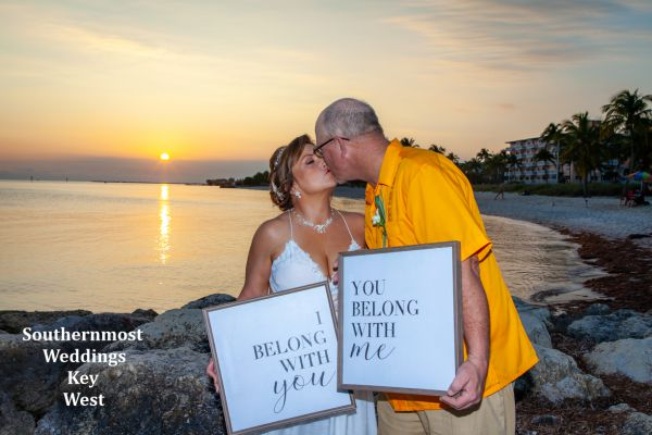 Wedding Couple pose with you belong with me Wedding Signs on Smathers Beach