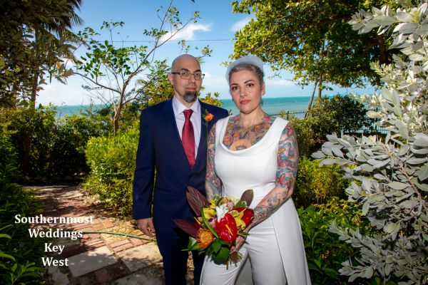Wedding couple poses for photos by Southernmost Weddings Key West