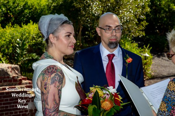 Wedding couple say their wedding vows in the West Martello Gardens