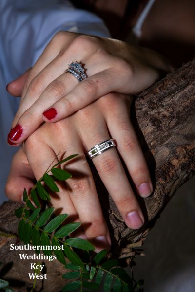 Photo of the wedding couples hands showing their wedding ring by Southernmost Weddings