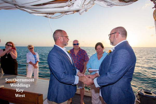 Wedding officiant from Southernmost Wedding Key West performs a ceremony during a private sunset sail overlooking the Gulf of Mexico
