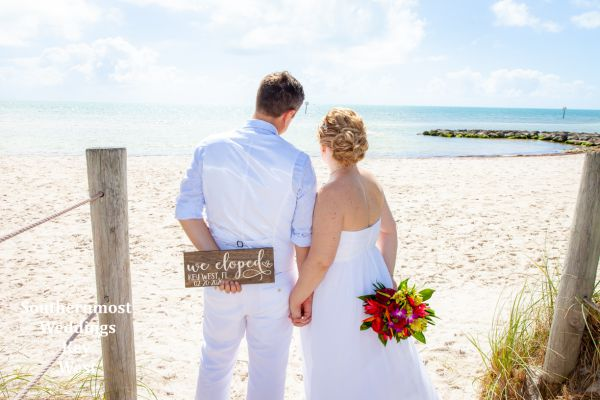 Bride & Groom overlooking the Atlantic Ocean after their casual wedding with Southernmost Weddings