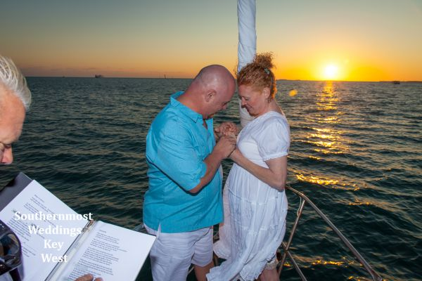 Bride & Groom exchange rings during their wedding ceremony planned by Southernmost Weddings Key West