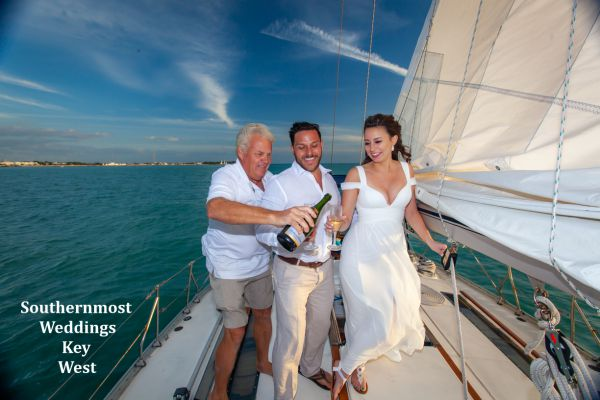 Bride & Groom celebrate their wedding by Southernmost Weddings Key West with a Champagne Toast