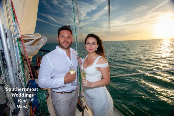 Private sunset sailboat weddings on the water where the Gulf of Mexico & the Atlantic Ocean meet the setting sun