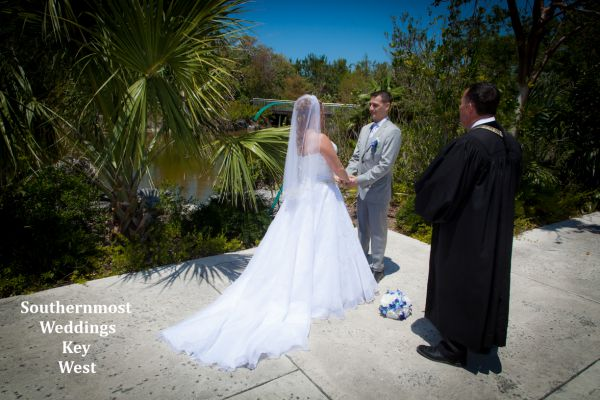 Wedding officiant from Southernmost Wedding performs a ceremony at the Key West Tropical Forest & Botanical Garden