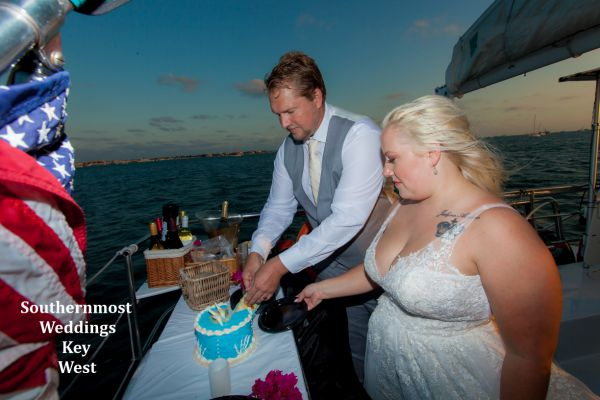 Wedding couple celebrate their wedding with some wedding cake after their wedding by Southernmost Weddings