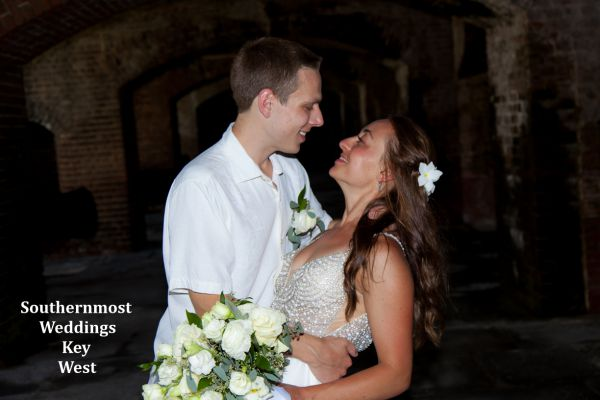 Wedding couple take some photos before their ceremony at Ft. Zachary Taylor