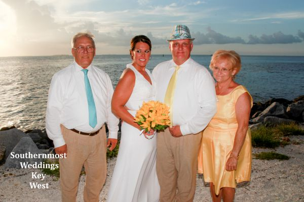 Wedding party poses for photos next to the Gulf of Mexico