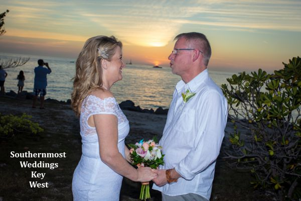 Bride & Groom stand in front of the setting sun after there wedding by Southernmost Weddings Key West