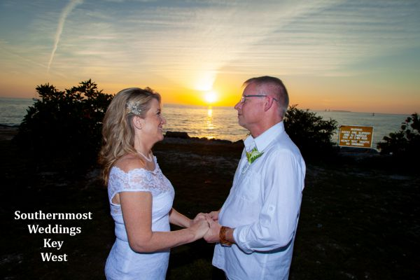 Wedding couple poses for photos overlooking the Gulf of Mexico by Southernmost Weddings Key West