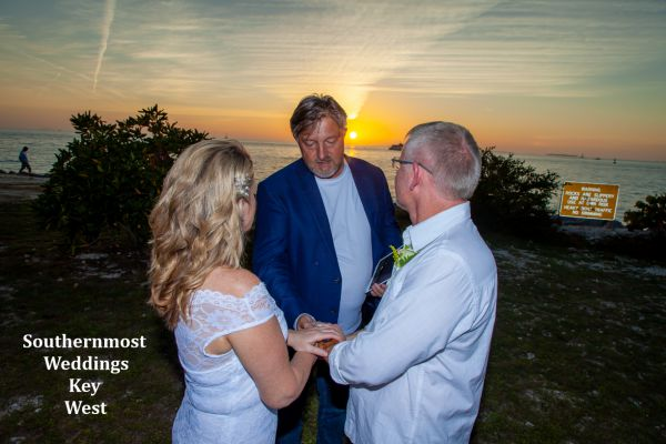Wedding couple getting married during sunset at Ft. Zachary Taylor in Key West, Florida