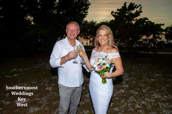 Wedding couple celebrate their wedding by Southernmost Weddings Key West with a Champagne Toast