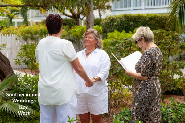 Wedding officiant performs a ceremony in the Truman Annex Butterfly Garden $295.00