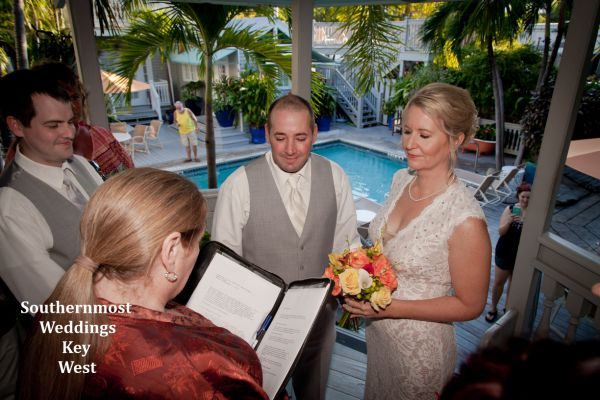 Wedding officiant marries a couple in the gazebo of their Key West Guesthouse