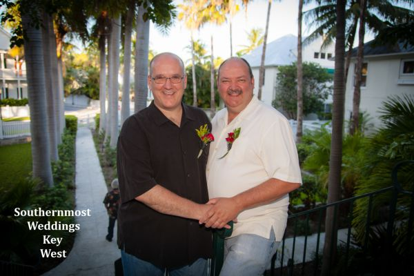 Wedding couple pose for photos after their wedding by Southernmost Weddings Key West
