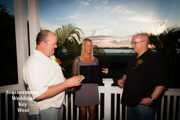 Two guy exchange vow at their Key West Guesthouse wedding by Southernmost Weddings