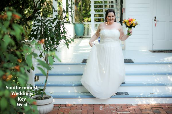 A bride walks down the steps of her guesthouse on her way to get married by Southernmost Weddings Key West