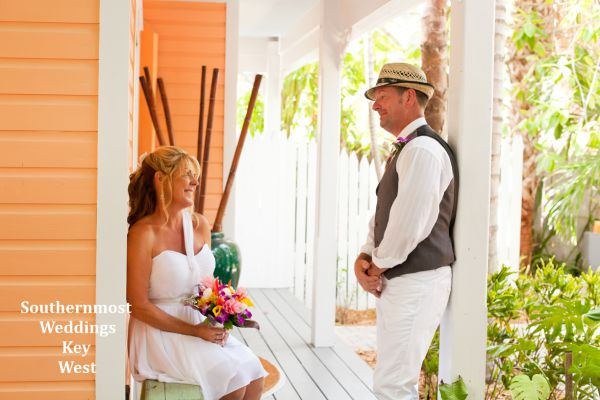 Wedding couple relaxes on the porch of their guesthouse before the wedding by Southernmost Weddings