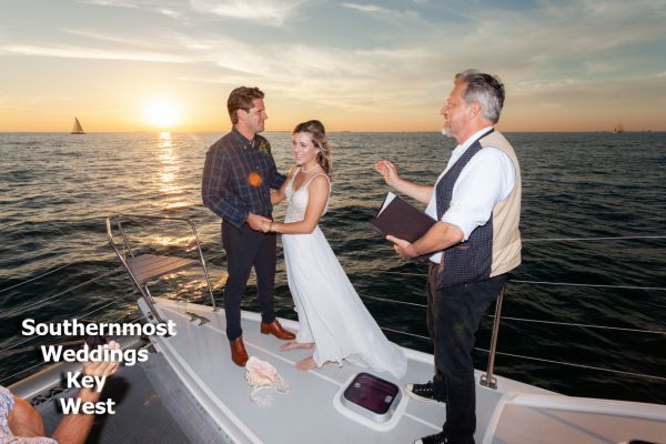 Wedding officiant from Southernmost Weddings performs a sunset ceremony on a private catamaran