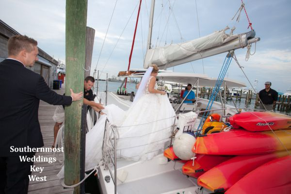 Wedding couple board their private sunset sail catamaran before their wedding by Southernmost Weddings Key West