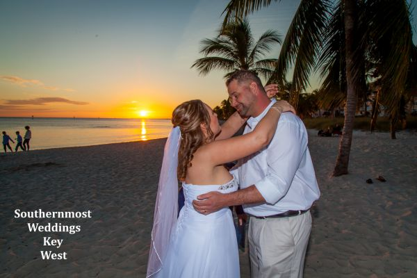 Wedding couple getting married at sunset on Smathers Beach in Key West, Florida by Southernmost Weddings