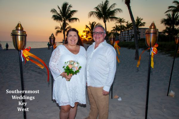 Wedding couple getting married on Smathers Beach by Southernmost Weddings Key West