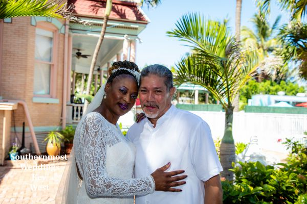 Wedding couple poses for photos at the Southernmost House by Southernmost Weddings Key West
