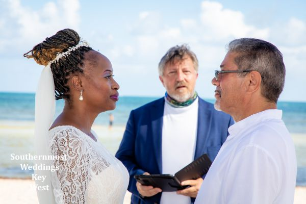 Wedding couple being married by Southernmost Weddings Key West on Smathers Beach