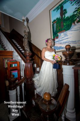 Bride poses for photos at the Southernmost House before her wedding by Southernmost Weddings