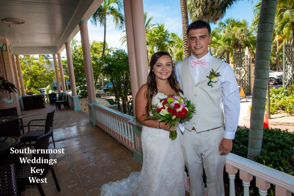 Wedding party pose for photos at the Southernmost House before their Barefoot Beach Wedding