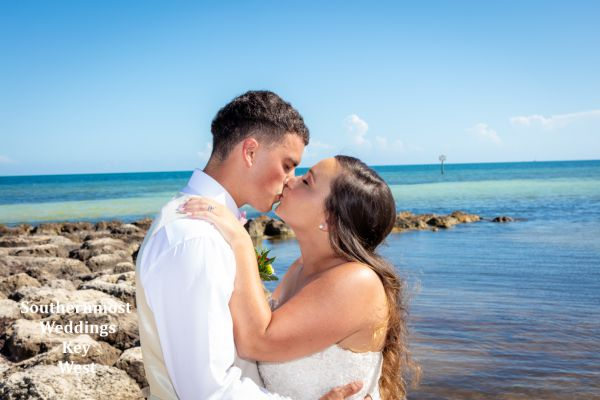 Wedding couple kisses after being married by Southernmost Weddings Key West