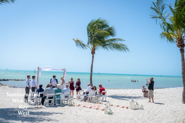 Beach Wedding with a Bamboo Arch, Island Decor & Chairs by Southernmost Weddings Key West
