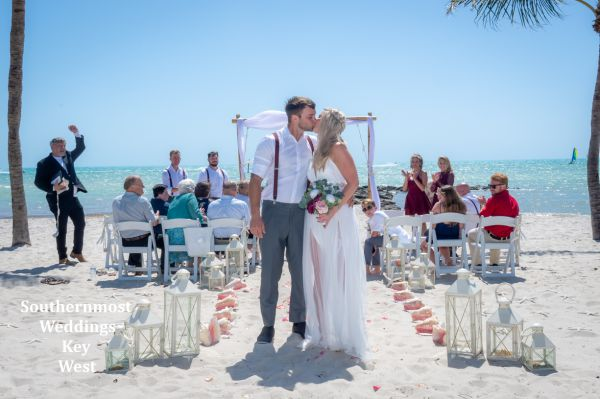 Bride & Groom kiss after their beach wedding by Southernmost Weddings Key West
