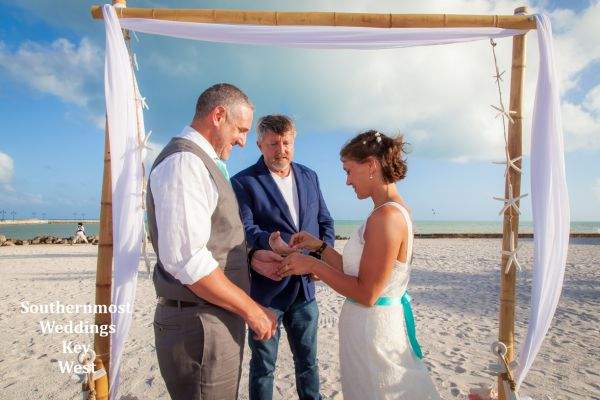 Wedding couple exchange vows during their wedding by Southernmost Weddings