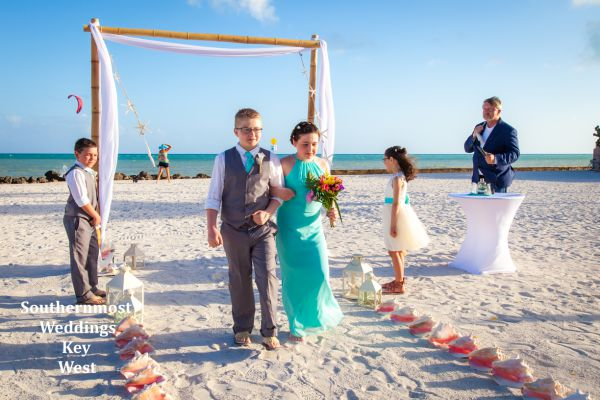 Beach Wedding with a Bamboo Arch and Island Decor by Southernmost Weddings