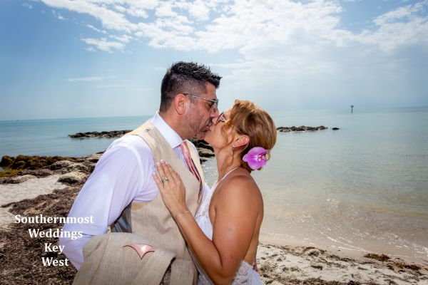 Bride & Groom kiss after their wedding on Smathers Beach by Southernmost Weddings Key West