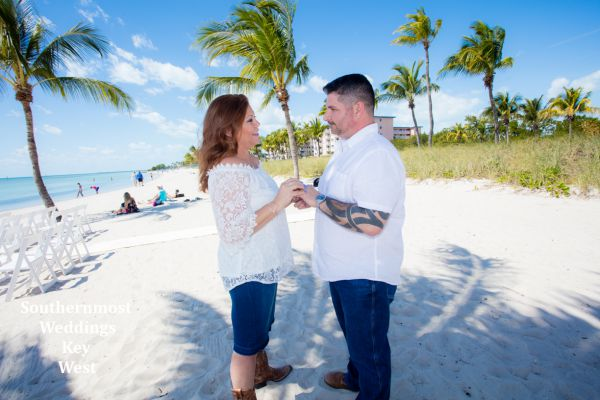 Bride & Groom say there wedding vows on Smathers Beach in Key West, Florida