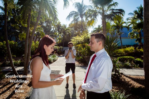 Wedding officiant from Southernmost Wedding performs a ceremony in the Truman Annex Tropical Pocket Garden