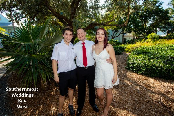 Wedding party pose for photos after their Truman Annex Tropical Garden Wedding by Southernmost Weddings