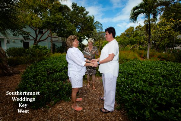 Wedding officiant marries a couple in the Truman Annex Butterfly Garden, Image by Southernmost Weddings