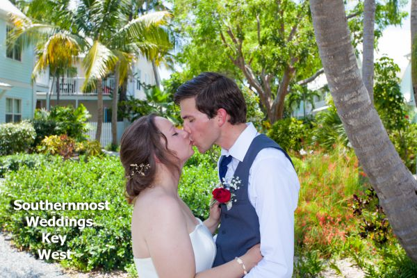 Wedding couple kisses after getting married by Southernmost Weddings