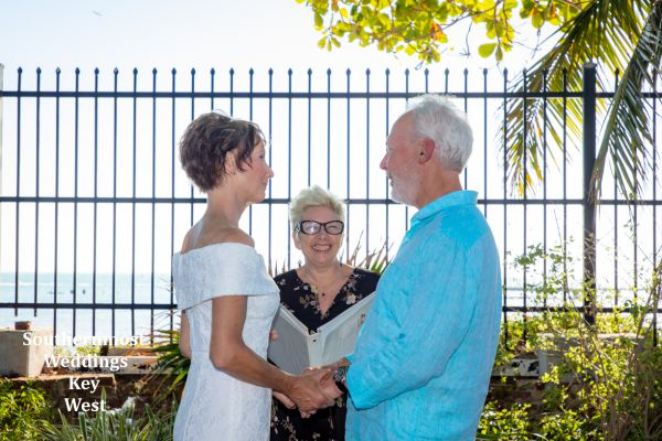 Wedding officiant marries a couple in the West Martello Towers Tropical Garden in Key West, Florida, Image by Southernmost Weddings